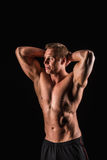 Muscular, strong and man isolated on black background Royalty Free Stock Image