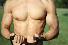 Muscular super-high level man pulls rubber bands Royalty Free Stock Photography