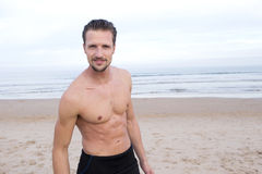 Muscular Surfer on Beach Royalty Free Stock Image