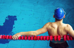 Muscular swimmer in a swimming pool.  Royalty Free Stock Images