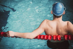 Muscular swimmer in a swimming pool.  Royalty Free Stock Photo