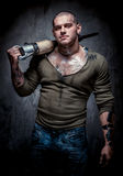 Muscular tattooed man with jackhammer Royalty Free Stock Photography