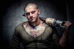 Muscular tattooed man with jackhammer Stock Image
