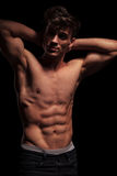 Muscular topless man flexing his arms Royalty Free Stock Photo