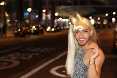 Muscular transvestite with beard and blonde wig royalty free stock photo