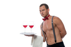 Muscular waiter with drinks for women Royalty Free Stock Photography