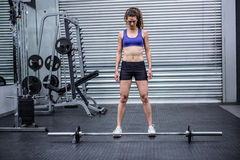 Muscular woman with barbell Royalty Free Stock Image