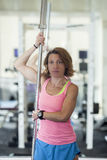 Muscular woman with barbell Stock Photos