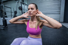 Muscular woman doing abdominal crunch Stock Photos