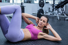 Muscular woman doing abdominal crunch Stock Images