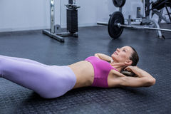 Muscular woman doing abdominal crunch Stock Photo