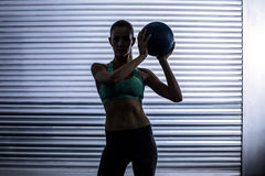 Muscular woman doing ball exercise Royalty Free Stock Photo