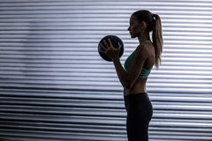 Muscular woman doing ball exercise Royalty Free Stock Photography