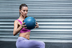 A muscular woman doing ball exercises Stock Image