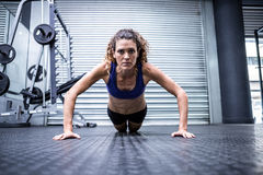Muscular woman doing push-ups Stock Image