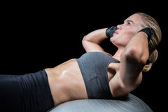 Muscular woman doing sit ups Royalty Free Stock Images