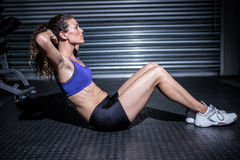 Muscular woman doing sit-ups. In crossfit gym Royalty Free Stock Photo