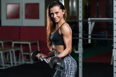 Muscular Woman Exercising Biceps With Barbell Royalty Free Stock Image