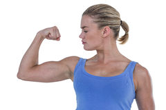 Muscular woman flexing her muscle Royalty Free Stock Photos