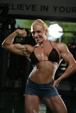 Muscular Woman Flexing Muscles Royalty Free Stock Photo