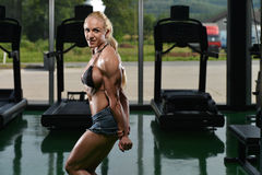 Muscular Woman Flexing Muscles Stock Photography
