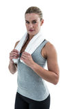 Muscular woman holding a towel around her neck Royalty Free Stock Photo