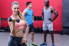 Muscular woman lifting a dumbbell Royalty Free Stock Photos