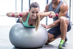 Muscular woman lifting a dumbbell Stock Photography