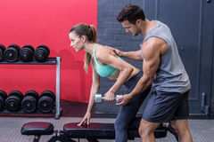 Muscular woman lifting a dumbbell Stock Photo