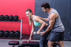 Muscular woman lifting a dumbbell Royalty Free Stock Image