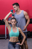 Muscular woman lifting a dumbbell Royalty Free Stock Images