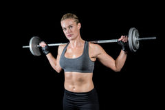 Muscular woman lifting heavy barbell Stock Photography