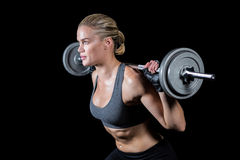 Muscular woman lifting heavy barbell Royalty Free Stock Photos