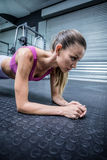A muscular woman on a plank position Stock Images
