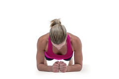 A muscular woman on a plank position. On white background Stock Photography
