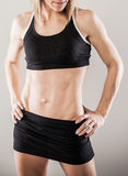 Muscular woman posing Royalty Free Stock Images