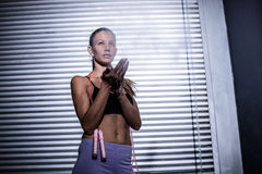 A muscular woman ready to use the jump rope Royalty Free Stock Images