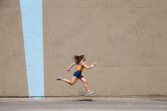 Muscular Woman Sprints To Win Royalty Free Stock Photos