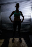 Muscular woman standing on a box Stock Photography