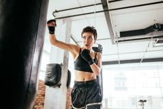Muscular woman succed in boxing. skillful sport. Keep physical fit stock photos