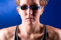 Muscular woman swimmer Stock Images