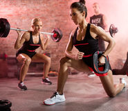 Muscular woman training with weights Royalty Free Stock Image