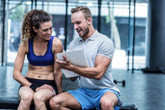 Muscular woman watching her results on clipboard Stock Image
