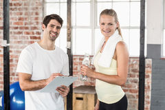 Muscular woman watching her results on clipboard Stock Photo