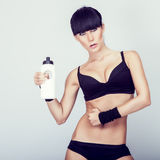muscular woman with water Royalty Free Stock Photo