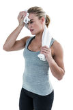 Muscular woman wiping herself with towel Royalty Free Stock Photo