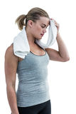 Muscular woman wiping herself with towel Stock Photos