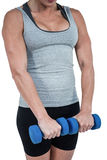 Muscular woman working out with dumbbells Stock Images