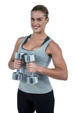Muscular woman working out with dumbbells Royalty Free Stock Photos