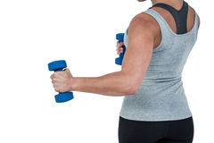 Muscular woman working out with dumbbells Stock Photography